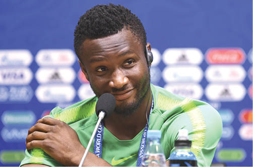 Super Eagles captain, Mikel Obi speaking during a press conference.